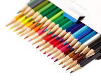 Colored pencils in box Royalty Free Stock Images