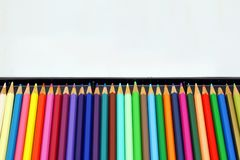 Colored pencils. In the box, Line of , Crayons royalty free stock photos