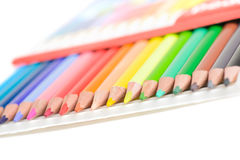 Colored pencils in box Stock Images
