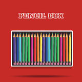 Colored pencils in box on red background Royalty Free Stock Photo