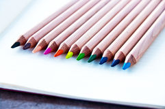 Colored pencils 2. Colored pencils, bright colors, on page of notebook paper with lines Royalty Free Stock Images