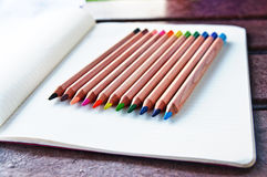 Colored pencils 1. Colored pencils, bright colors, on page of notebook paper with lines Royalty Free Stock Photo