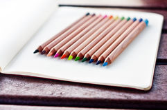 Colored pencils 3. Colored pencils, bright colors, on page of notebook paper with lines Stock Photography