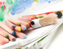 Colored pencils and brush Royalty Free Stock Images