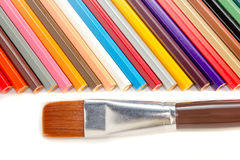 Colored pencils and brush on white background Royalty Free Stock Photography