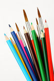 Colored pencils and brushes. On a white background Stock Image
