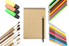Colored pencils, brushes, notebook mock up for artwork with watercolor paints. Branding stationery mockup scene, blank objects for placing your design royalty free stock photos