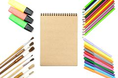 Colored pencils, brushes, notebook mock up for artwork with watercolor paints. Branding stationery mockup scene, blank objects for placing your design royalty free stock photography