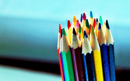Colored pencils. Bunch of colored pencils in bright, and dark tones Stock Photos