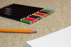 Colored pencils on burlap Stock Image