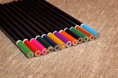 Colored pencils on burlap Stock Photography