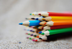 Colored pencils on burlap background Stock Image