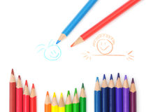 Colored Pencils On Child's Drawing Royalty Free Stock Photos