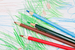 Colored pencils on children draw Royalty Free Stock Photos