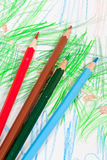 Colored pencils on children picture Royalty Free Stock Photography