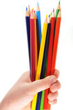 Colored pencils in a children's hand isolated Royalty Free Stock Photos