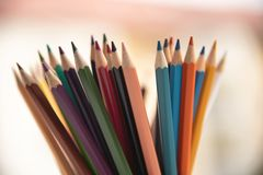 Colored pencils for children and schoolchildren to paint stock photography