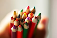 Colored pencils in children's hands, sharpened Royalty Free Stock Photos