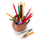 Colored pencils in a clay jug Royalty Free Stock Photos