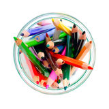 Colored pencils in a clear glass jar. top view Stock Images