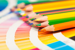 Colored pencils and color chart of all colors Royalty Free Stock Photos