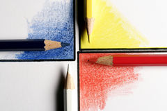 Colored pencils on colored corners arranged as a crossroads. Painted with pencils Royalty Free Stock Photo