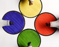 Colored pencils on colored papers arranged as a crossroads with circles. Colored pencils on colored corners arranged as a crossroads with full colors on rounded Stock Photos