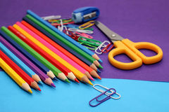 Colored pencils, colored paper for creativity. Stock Photo