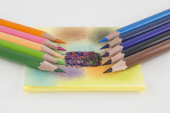 Colored pencils and colored paper Royalty Free Stock Image