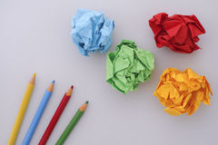 Colored pencils and colorful paper balls Royalty Free Stock Photos