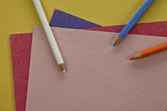 Colored pencils on colorful paper. Stock Image