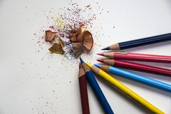 Colored pencils with colorful pencil shavings. On white background. Back to school concept Royalty Free Stock Image