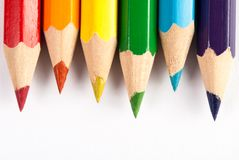 Colored pencils in the colors of rainbow on white background stock photo