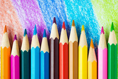 Colored pencils. On the coloured background royalty free stock photo