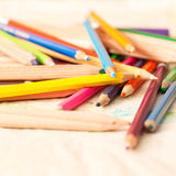 Colored pencils. Coloured pencils scattered on a table Stock Photo