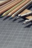 Colored pencils,compass and set square Royalty Free Stock Images