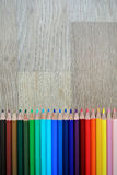 Colored pencils composition. The colored pencils ordered composition royalty free stock photography