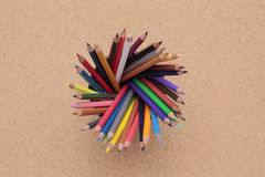 Colored pencils  on cork background Royalty Free Stock Photos