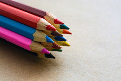 Colored pencils on craft paper Royalty Free Stock Photography
