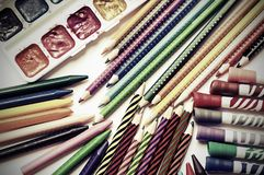 Colored pencils, crayons, markers and paints on white background Stock Images
