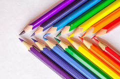 Colored pencils crossed on white background. Set of colored pencils isolated against the white background. Close up, crossed pencils Royalty Free Stock Images
