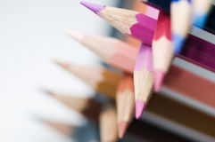 Colored pencils crossing Stock Images