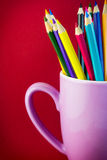 Colored pencils in a cup Stock Images