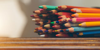 Colored pencils. On a dark wooden background Stock Images