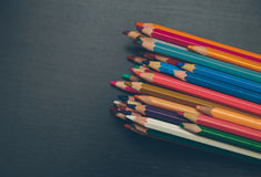 Colored pencils. On a dark wooden background Stock Image