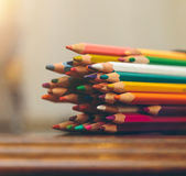 Colored pencils. On a dark wooden background Royalty Free Stock Photos