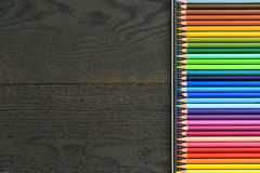 Colored pencils dark wooden background Stock Photo