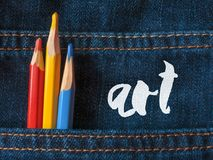 Colored pencils on denim. Lettering Art. Beautiful school draw blue background Royalty Free Stock Images