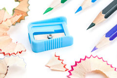 Colored pencils of different colors and a pencil sharpener and pencil shavings Royalty Free Stock Photo