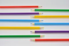 Colored pencils of different shapes stock photo